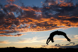 gymnast in sunset doing a back handspring