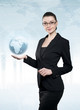 Attractive young biznesswoman holding a modern globe