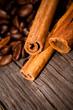 Macro photo of coffee beens with cinnamon, low depth of focus