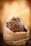 Burlap bag full of coffee beans with smoke