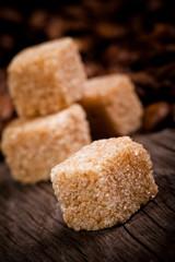 Macro shot of brown sugar on wooden surface