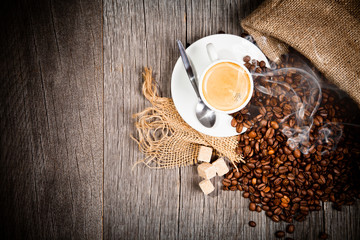 Coffee still life on wooden surface, upper view