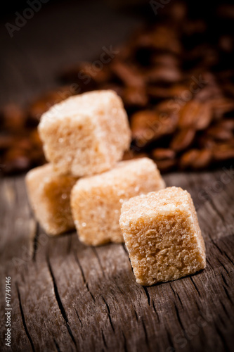 Macro shot of brown sugar on wooden surface