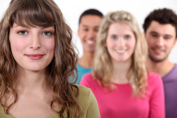 Woman standing in front of her peer group