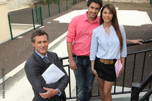 Estate agent and young couple