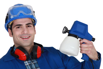 Tradesman holding a spray gun