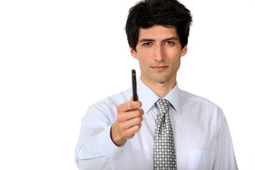 Businessman confidently holding pen