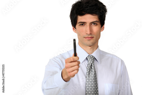 Businessman confidently holding pen