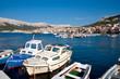 Boats on port at Baska background Baska old town - Krk - Croatia