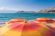 Orange Sunshades on beach at baska - Krk - Croatia