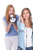 girl listening music while he friends is singing