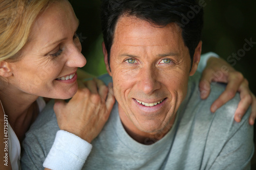 Middle-aged couple smiling