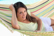 Young brown-haired woman laid in hammock