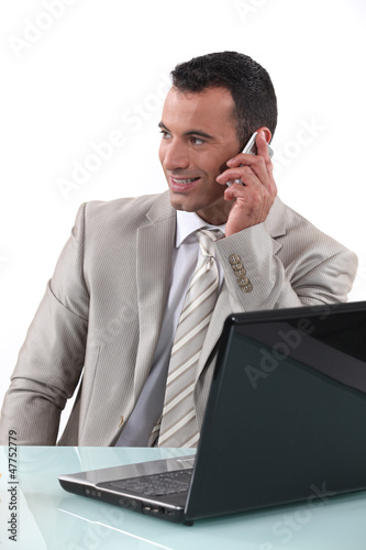 Worker on the phone in front of computer