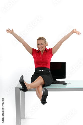 Relaxed woman sitting on her desk