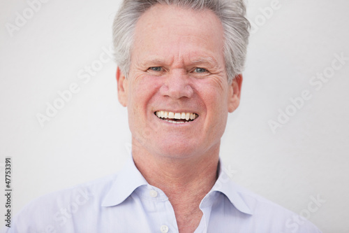 Stock image of a businessman laughing