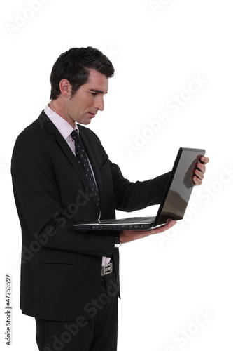 Businessman carrying laptop