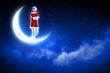 photo of santa girl sitting on the moon