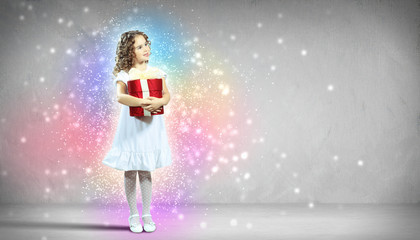 Happy girl opening gift box