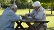 Active retirement and free time, four elderly men playing chess
