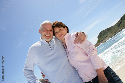 Old couple at the beach enjoying their retirement