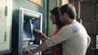 Young couple withdrawing money from an ATM, steadycam shot