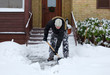 Man removing snow in front of his house