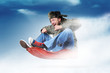 Man flying on a sleigh, concept festive sledging