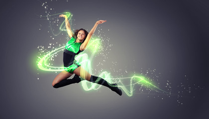 Young woman dancer. With lights effect.