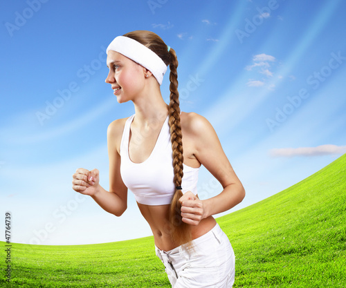 Young pretty woman in sport wear running