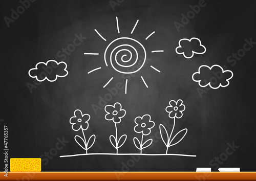 Drawing of sun and flowers on blackboard