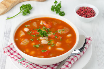 bowl of roasted tomato soup with beans, celery and bell pepper