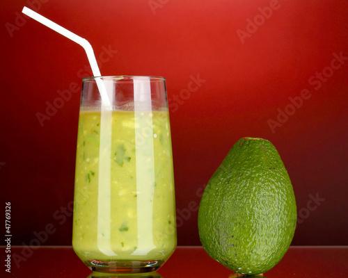 Useful fresh avocado on dark red background