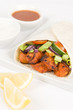 Chicken Tikka Wrap: Tandoori chicken and salad in a flatbread