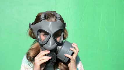 nuclear war. Girl dress gas masks. green screen.
