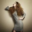 Portrait of beautiful woman in knitted dress