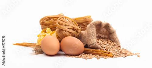 pasta assortment and ingredients isolated on white background