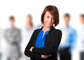 Smiling businesswoman with a group of young businesspeople