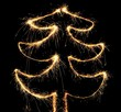 Abstract sparkler christmas tree on the black background.