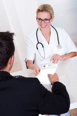 Female doctor consulting with a patient