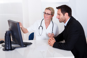 Doctor explaining something to a male patient