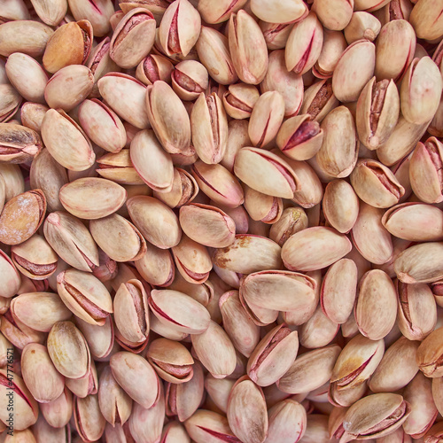 tasty pistachio nuts , food background