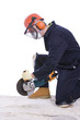 workman with angle grinder