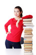 Happy young student woman with books
