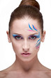 Fashion make-up with face art.