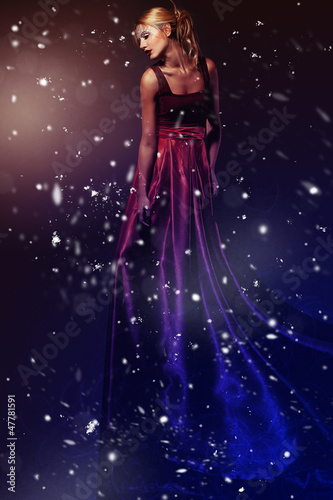 Romantic beauty woman in elegant red dress. Professional makeup