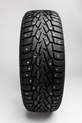 winter tire on grey background