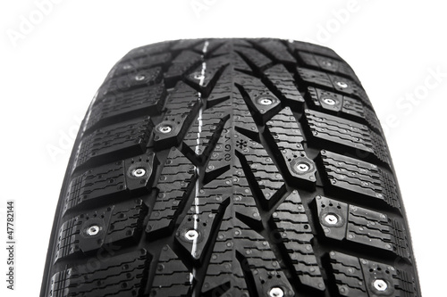 winter tire with snow spikes and protector
