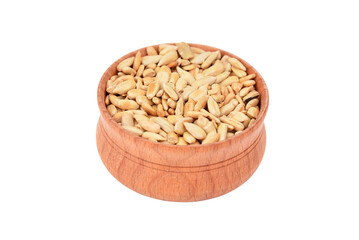 Sunflower seeds in wooden bowl, isolated on white background