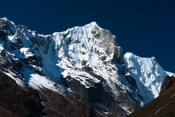 Snowbound mountain range and blue sky in Himalayas